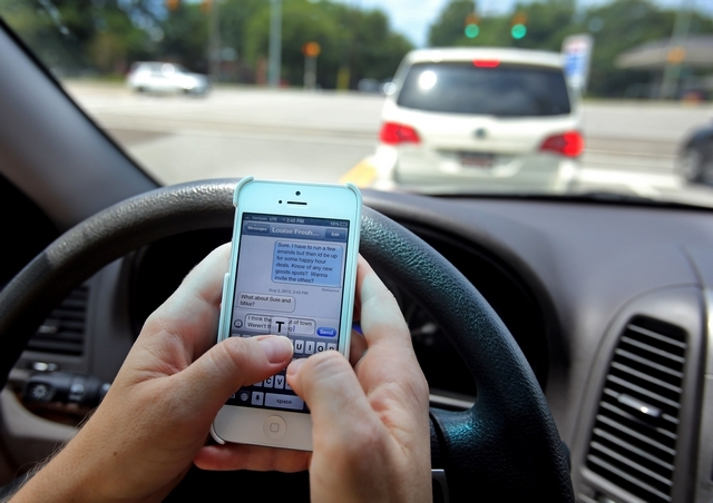 A driver texting in traffic